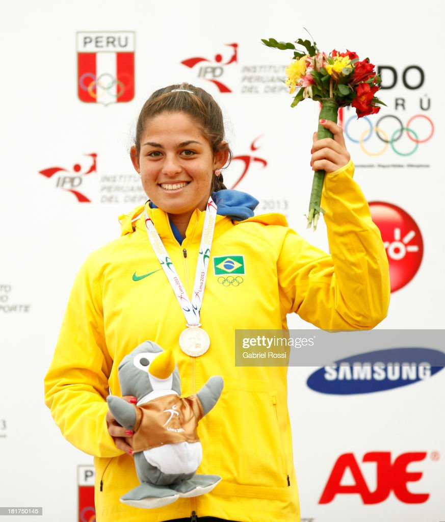 Carolina Alves of Brazil poses with her bronze medal after the Final match as part of the I ODESUR South American Youth Games at Club Lawn Tenis de la Exposicion on September 24, 2013 in Lima, Peru.