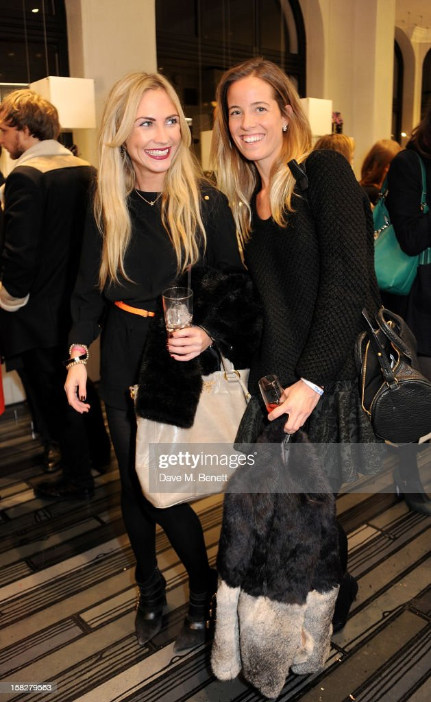 Carolina Bunster (L) and Ashley Warwa attend a Christmas drinks hosted by designer Nicholas Kirkwood to celebrate his partnership with Chambord black raspberry liquer, and launch the limited edition shoe 'The Chambord' at the Nicholas Kirkwood Mount Street store on December 12, 2012 in London, England.