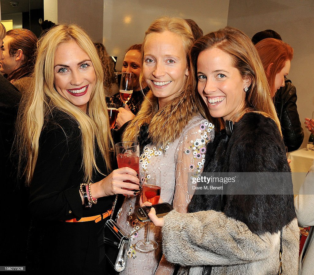 Carolina Bunster, Martha Ward and Ashley Warwa attend a Christmas drinks hosted by designer Nicholas Kirkwood to celebrate his partnership with Chambord black raspberry liquer, and launch the limited edition shoe 'The Chambord' at the Nicholas Kirkwood Mount Street store on December 12, 2012 in London, England.