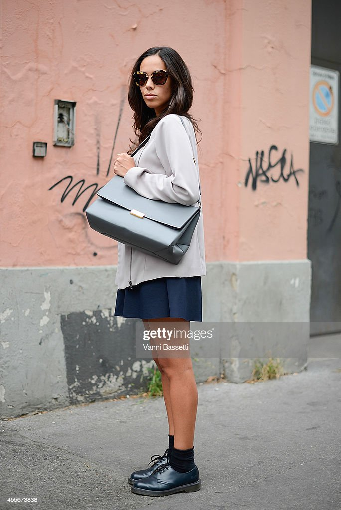 Carolina Cerutti poses wearing a COS top vintage skirt Stella McCartney bag and Dr Martens shoes on September 18 2014 in Milan Italy