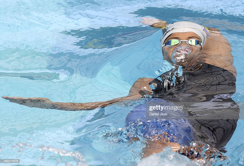 Carolina Colorado of Colombia competes to set a new Bolivarian record in the women's 100m backstroke with a time of 10371 during the swimming event...