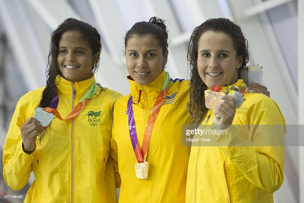 Carolina Colorado of Colombia poses after winning the gold medal with Natalia de Luccas and Etiene Pires of Brazil in womens 100m backstroke final...