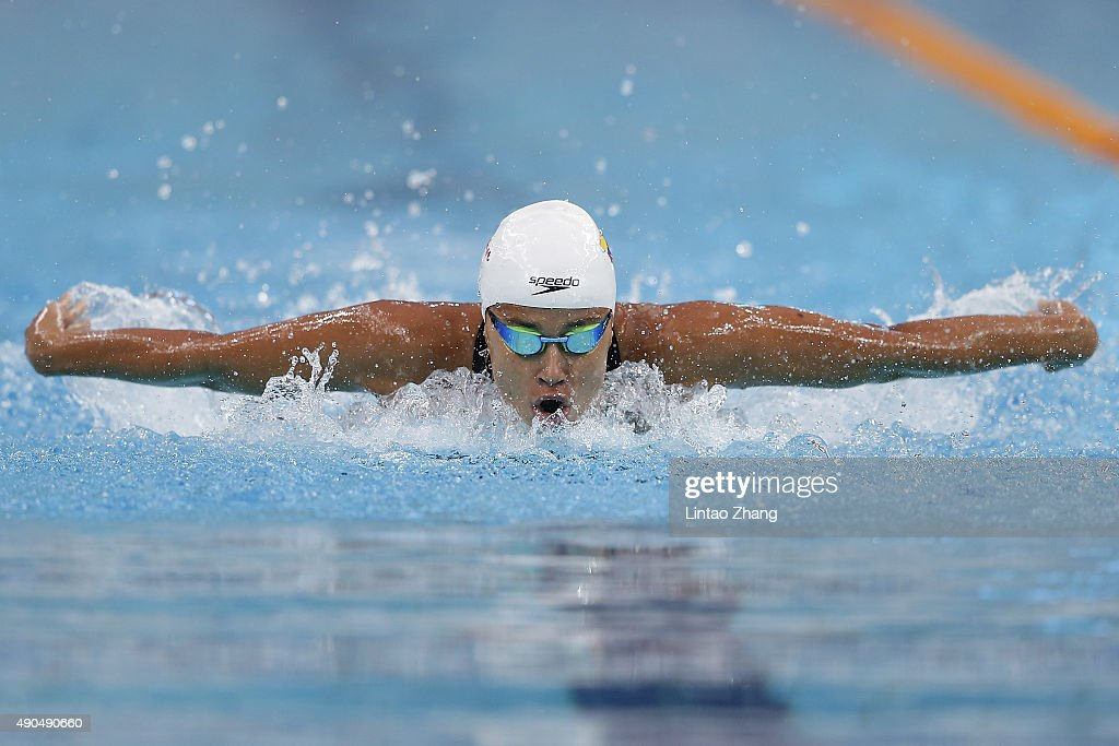 Carolina Colorado of Columbia competes in the Women's 100meter Butterfly preliminaries at the National Aquatics Centre during day one of 2015 FINA...