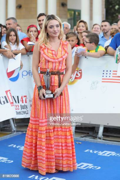 Carolina Crescentini pose with the Giffoni Award during the Giffoni Film Festival 2017 blue carpet on July 20 2017 in Giffoni Valle Piana Italy