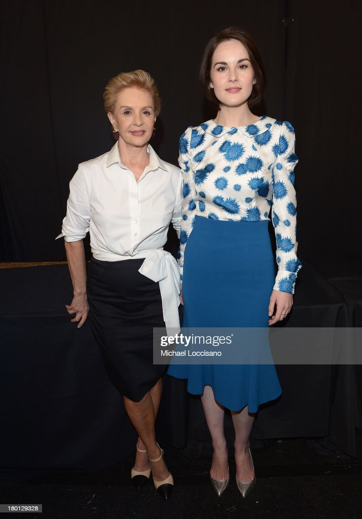 Carolina Herrer (L) and <a gi-track='captionPersonalityLinkClicked' href=/galleries/search?phrase=Michelle+Dockery&family=editorial&specificpeople=4047702 ng-click='$event.stopPropagation()'>Michelle Dockery</a> pose backstage at the Carolina Herrera fashion show during Mercedes-Benz Fashion Week Spring 2014 at The Theatre at Lincoln Center on September 9, 2013 in New York City.