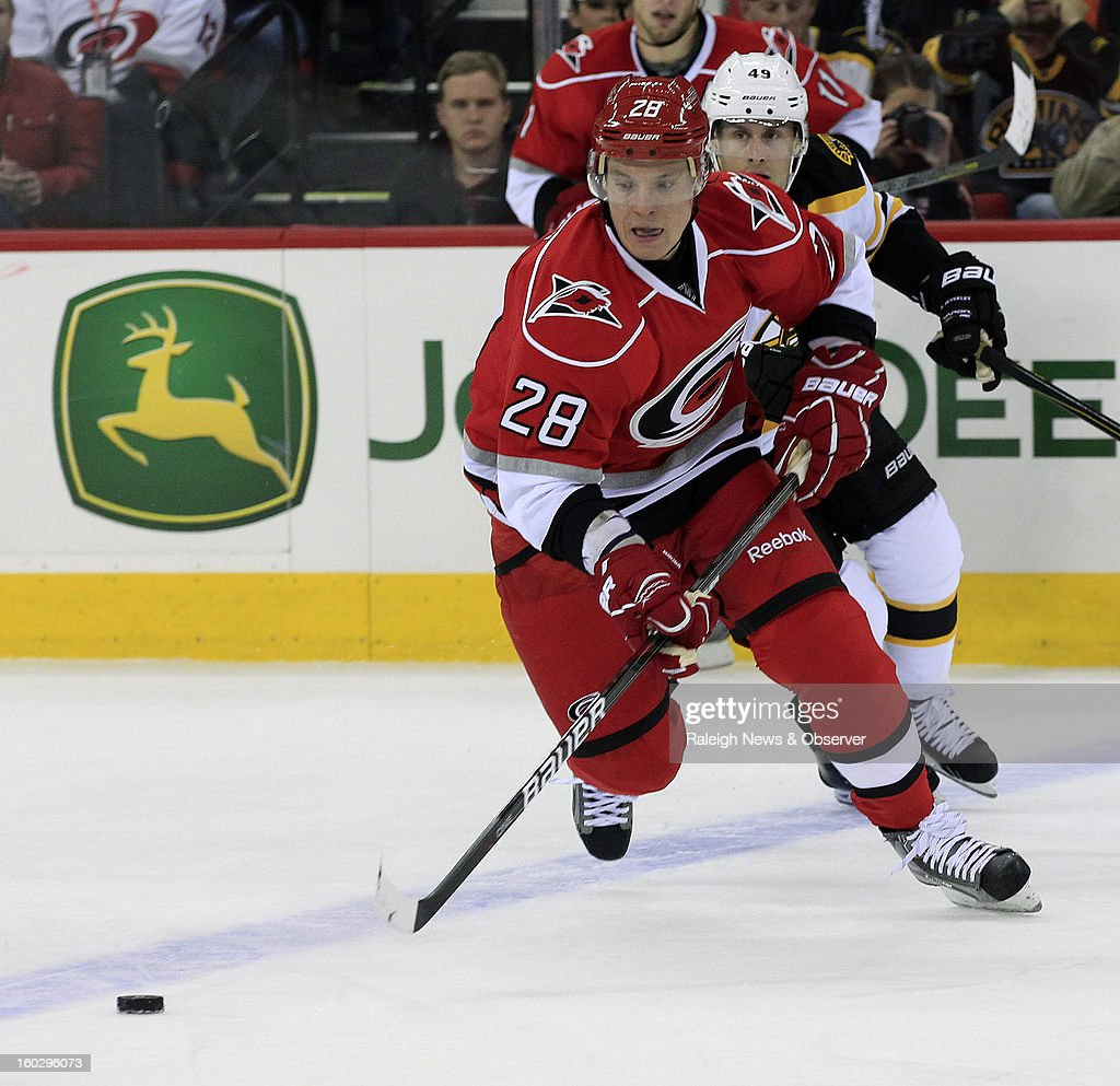 Carolina Hurricanes Alexander Semin (28) moves the puck during the first period of an NHL game against the Boston Bruins at PNC Arena in Raleigh, North Carolina, Monday, January 28, 2013.