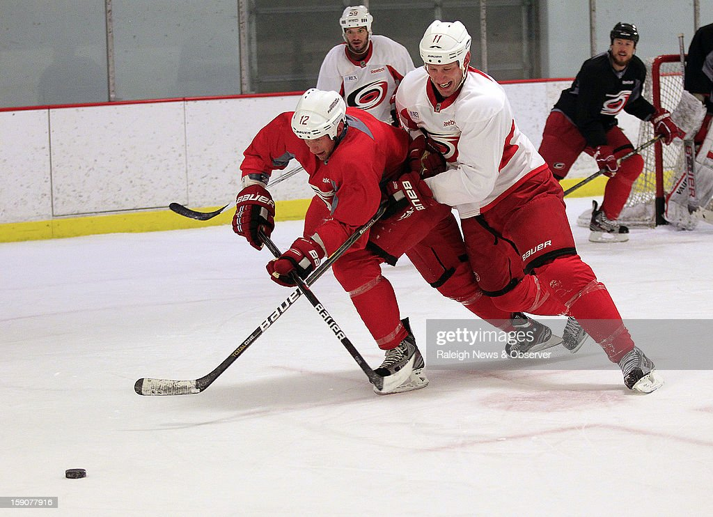 Carolina Hurricanes captain Eric Staal, left, battles his brother Jordan Staal for the puck as the Canes workout at Raleigh Center Ice in Raleigh, North Carolina, Monday, January 7, 2013.