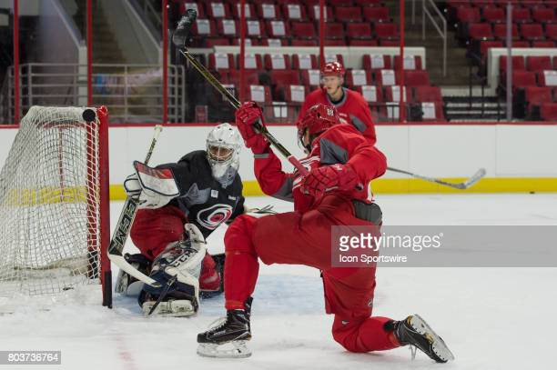 Carolina Hurricanes Center Martin Necas has a puck hit the post in front of Carolina Hurricanes Goalie Eetu Makiniemi during the Carolina Hurricanes...
