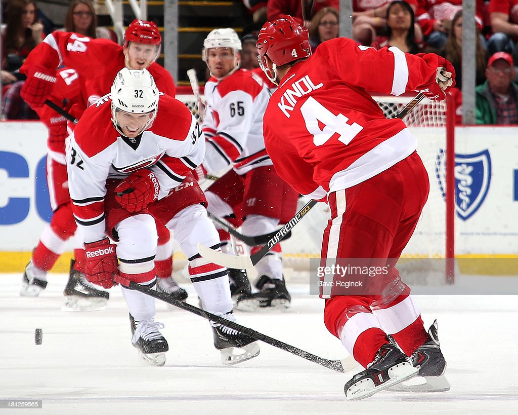 Carolina Hurricanes center <a gi-track='captionPersonalityLinkClicked' href=/galleries/search?phrase=Zach+Boychuk&family=editorial&specificpeople=2140248 ng-click='$event.stopPropagation()'>Zach Boychuk</a> #32 blocks a shot from Detroit Red Wings defenseman <a gi-track='captionPersonalityLinkClicked' href=/galleries/search?phrase=Jakub+Kindl&family=editorial&specificpeople=716743 ng-click='$event.stopPropagation()'>Jakub Kindl</a> #4 during an NHL game on April 11, 2014 at Joe Louis Arena in Detroit, Michigan.