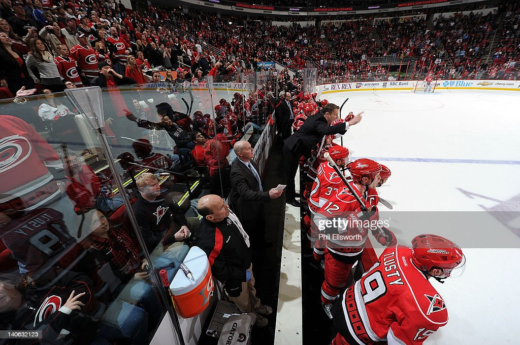 Carolina Hurricanes Coach Kirk Muller and the team bench reacts to a penalty called on Brandon Sutter during the overtime period of an NHL game against the Tampa Bay Lightning on March 3, 2012 at RBC Center in Raleigh, North Carolina.