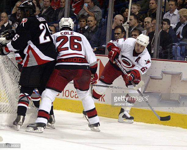 Carolina Hurricanes' Corey Stillman makes a pass from behind the net during a game against the Buffalo Sabres at the HSBC Arena in Buffalo NY...