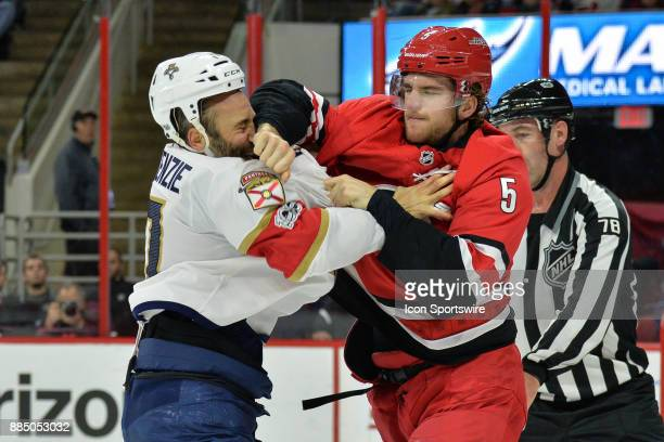Carolina Hurricanes Defenceman Noah Hanifin and Florida Panthers Center Derek MacKenzie fight during a game between the Florida Panthers and the...