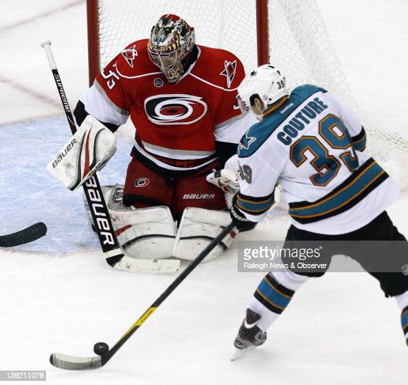 Carolina Hurricanes goalie Justin Peters denies the San Jose Sharks' Logan Couture during the second period at the RBC Center in Raleigh North...