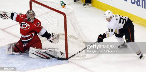 Carolina Hurricanes goalie Justin Peters stops a shot by the Anaheim Ducks' Jason Blake during the second period at the RBC Center in Raleigh North...