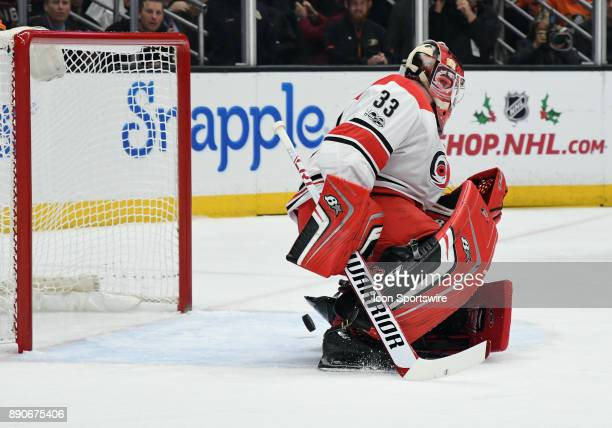 Carolina Hurricanes goalie Scott Darling can't stop the puck as it slips past for a goal in the first period of a game against the Anaheim Ducks on...