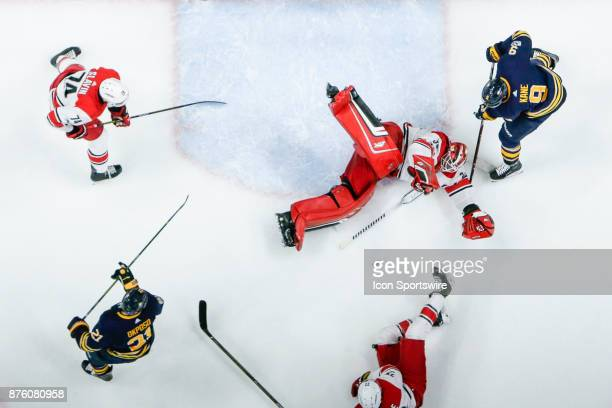 Carolina Hurricanes Goalie Scott Darling sprawls on the ice as Buffalo Sabres Left Wing Evander Kane looks for rebound during the Carolina Hurricanes...