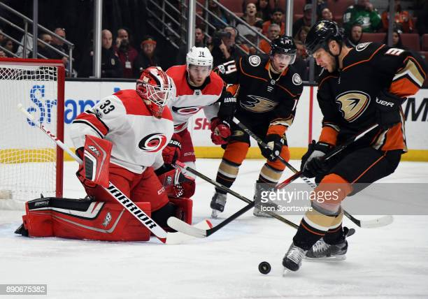 Carolina Hurricanes goalie Scott Darling watches Anaheim Ducks defenseman Kevin Bieksa with the puck in the first period of a game against the...
