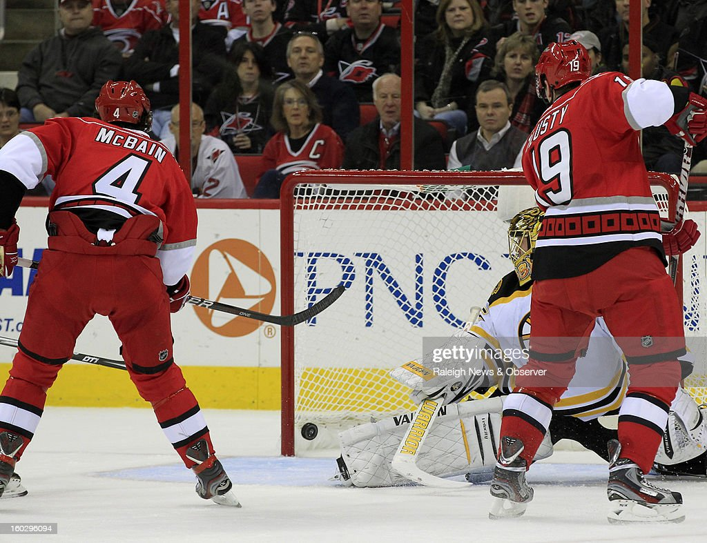Carolina Hurricanes Jamie McBain (4) puts the puck past Boston Bruins' Anton Khudobin (35) during the first period of an NHL game at PNC Arena in Raleigh, North Carolina, Monday, January 28, 2013.