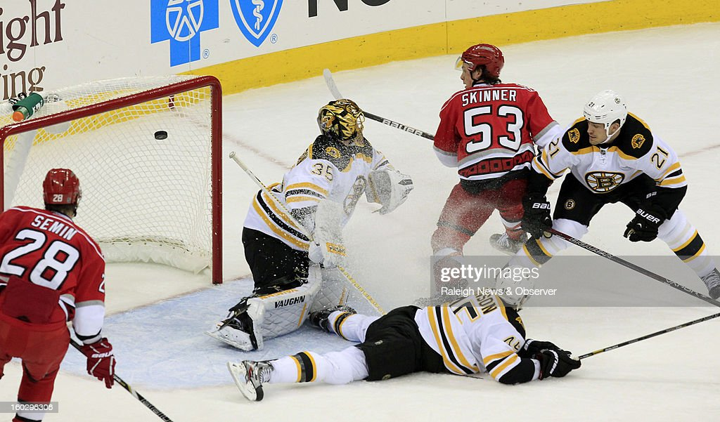 Carolina Hurricanes' Jeff Skinner (53) puts the puck past Boston Bruins' Anton Khudobin (35), Aaron Johnson (45) and Andrew Ference (21) for a goal during the second period at PNC Arena in Raleigh, North Carolina, Monday, January 28, 2013.
