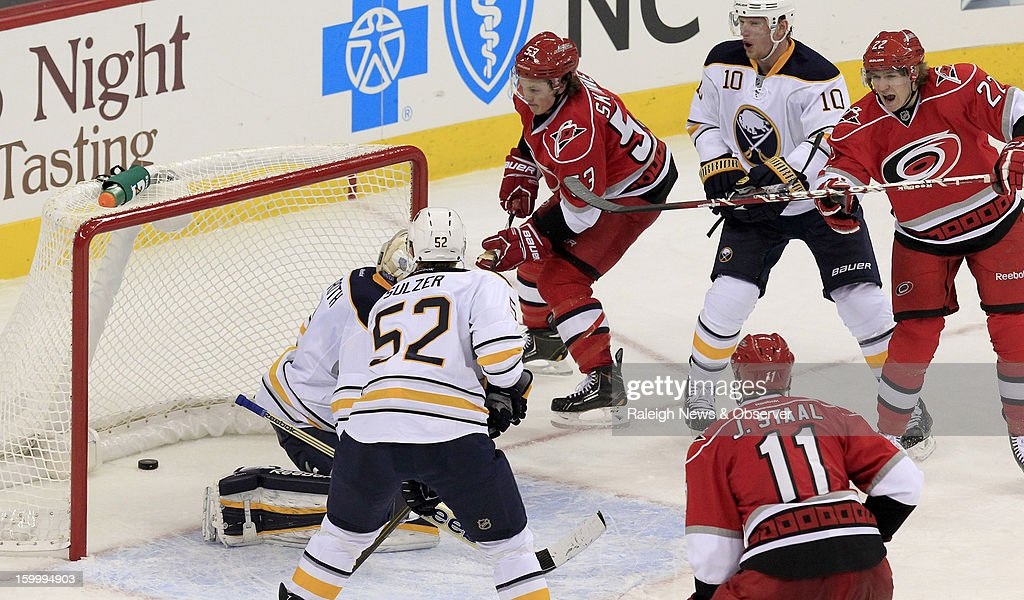 Carolina Hurricanes' Jeff Skinner (53) scores his second goal against Buffalo Sabres' Jhonas Enroth (1), Alexander Sulzer (52) and Christian Ehrhoff (10) during second-period action at PNC Arena in Raleigh, North Carolina, Thursday, January 24, 2013.