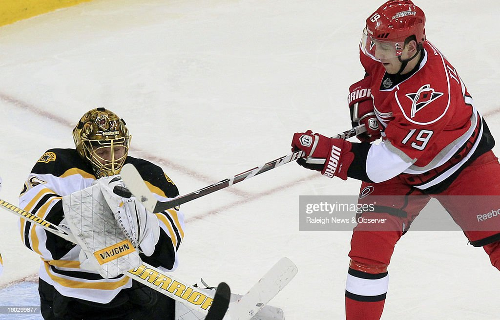 Carolina Hurricanes' Jiri Tlusty (19) has his shot blocked by Boston Bruins' Anton Khudobin (35) during the second period at PNC Arena in Raleigh, North Carolina, Monday, January 28, 2013. The Bruins beat the Hurricanes 5-3.