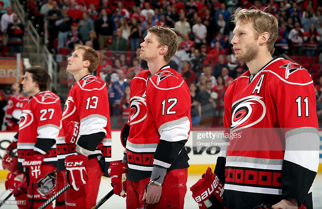 Carolina Hurricanes Justin Faulk #27, Jared Staal #13, Eric Staal #12 and Jordan Staal #11 are pictured during the National Anthem prior to an NHL game against the New York Rangers during their NHL game at PNC Arena on April 25, 2013 in Raleigh, North Carolina. Eric and Jordan Staal will be joined by 22-year-old brother Jared for the first time in a Hurricanes sweater as he makes his NHL debut tonight.