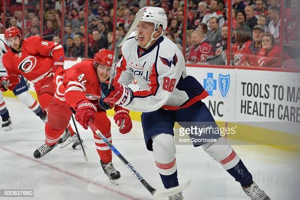 Carolina Hurricanes left wing Joakim Nordstrom defends against Washington Capitals defenseman Nate Schmidt in a regular season NHL game between the...