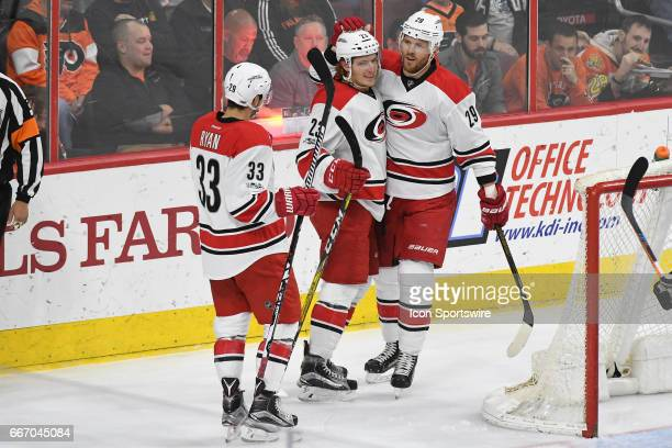 Carolina Hurricanes Right Wing Brock McGinn is congratulated on his goal by Carolina Hurricanes Left Wing Bryan Bickell and Carolina Hurricanes...