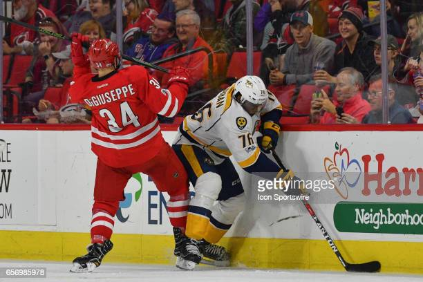 Carolina Hurricanes Right Wing Phillip Di Giuseppe and Nashville Predators Defenceman PK Subban fight for a puck along the boards in a game between...