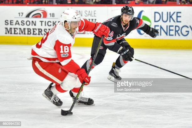 Carolina Hurricanes Right Wing Phillip Di Giuseppe chases after Detroit Red Wings Defenceman Robbie Russo in a game between the Detroit Red Wings and...