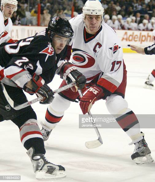 Carolina Hurricanes' Rod Brind'Amor and Sabres' Chris Drury during a game at the HSBC Arena in Buffalo NY on November 09 2005 The Hurricanes defeated...