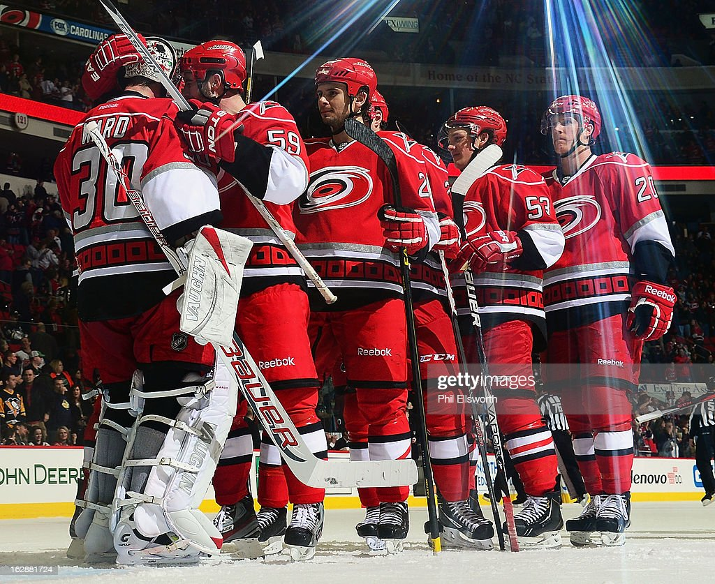 Carolina Hurricanes teammates line up to congratulate Cam Ward #30 following the team's 4-1 victory over the Pittsburgh Penguins after an NHL game on February 28, 2013 at PNC Arena in Raleigh, North Carolina.