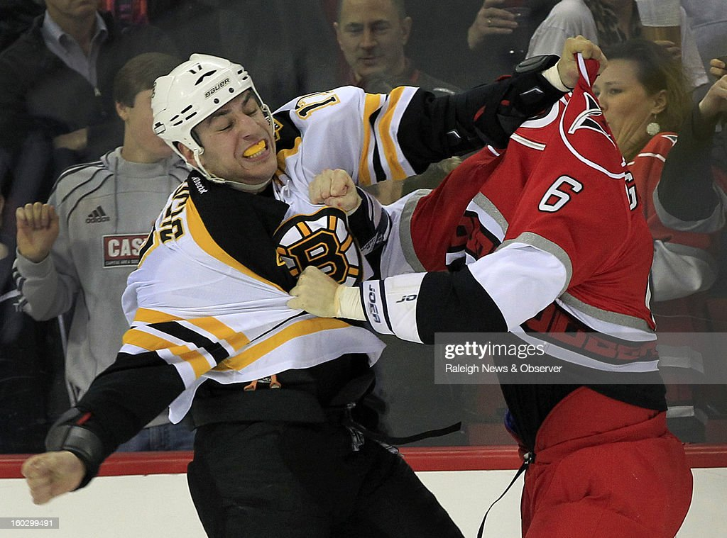Carolina Hurricanes' Tim Gleason (6) brawls with Boston Bruins' Milan Lucic (17) during the first period at PNC Arena in Raleigh, North Carolina, Monday, January 28, 2013. The Bruins beat the Hurricanes 5-3.