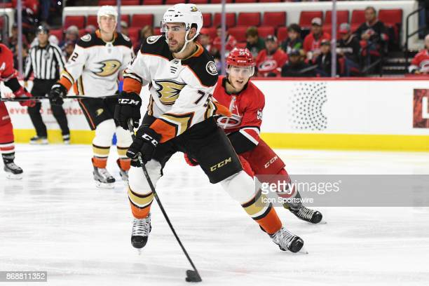 Carolina Hurricanes Winger Janne Kuokkanen chases after Anaheim Ducks Defenceman Jaycob Megna during a game between the Anaheim Ducks and the...
