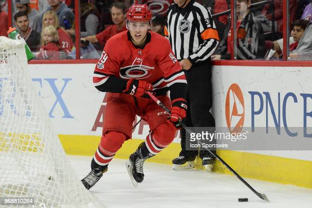 Carolina Hurricanes Winger Janne Kuokkanen skates with a puck during a game between the Anaheim Ducks and the Carolina Hurricanes at the PNC Arena in...