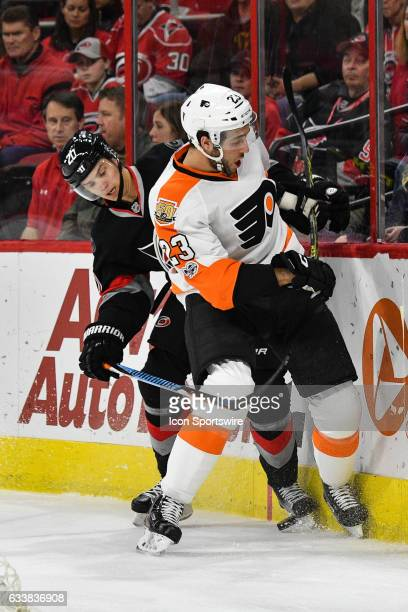 Carolina Hurricanes Winger Sebastian Aho and Philadelphia Flyers Defenceman Brandon Manning get tied up along the boards going after a loose puck in...