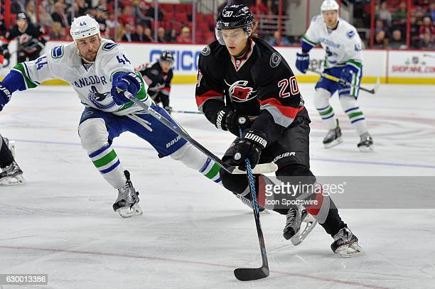 Carolina Hurricanes Winger Sebastian Aho is defended by Vancouver Canucks Defenceman Erik Gudbranson in the first period of a regular season NHL game...
