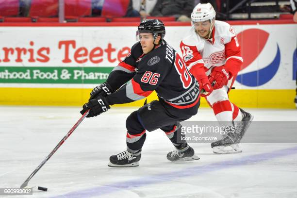 Carolina Hurricanes Winger Teuvo Teravainen skates away from Detroit Red Wings Defenceman Robbie Russo in a game between the Detroit Red Wings and...