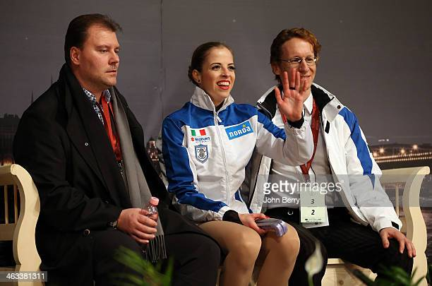 Carolina Kostner of Italy and her coach Michael Huth react to the results in the Ladies Free Skating event of the ISU European Figure Skating...