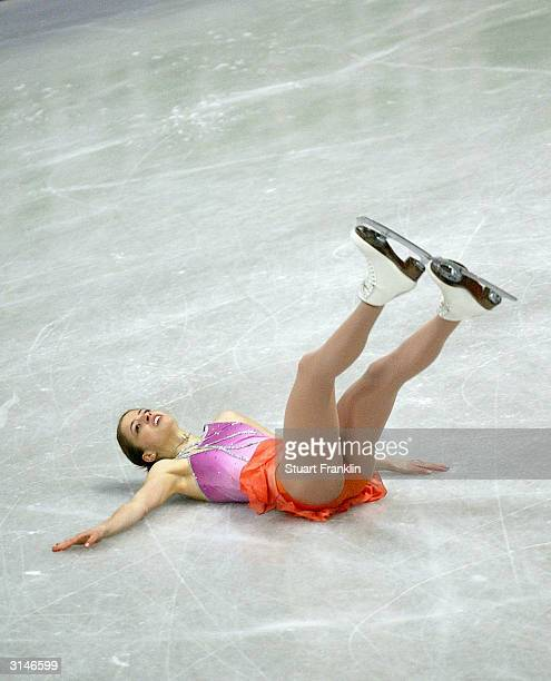 Carolina Kostner of Italy falls on the ice during the ladies free skating program at the 2004 World Figure Skating championships at Westfalenhalle on...