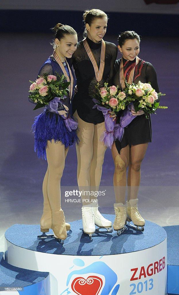 Carolina Kostner of Italy (C) poses beside Adelina Sotnikova of Russia (L) and Elizaveta Tuktamysheva of Russia after the women's free skating program during European Figure Skating Championship in Zagreb, on January 26, 2013. Kostner won the gold medal while Adelina Sotnikova of Russia (L) took silver and Elizaveta Tuktamysheva of Russia (R) took bronze medal.