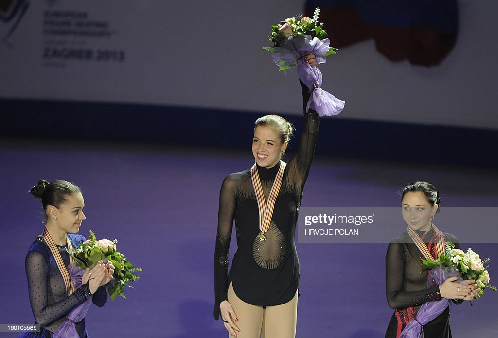 Carolina Kostner of Italy (C) poses beside Adelina Sotnikova of Russia (L) and Elizaveta Tuktamysheva of Russia after the women's free skating program during European Figure Skating Championship in Zagreb, on January 26, 2013. Kostner won the gold medal while Adelina Sotnikova of Russia (L) took silver and Elizaveta Tuktamysheva of Russia (R) took bronze medal.