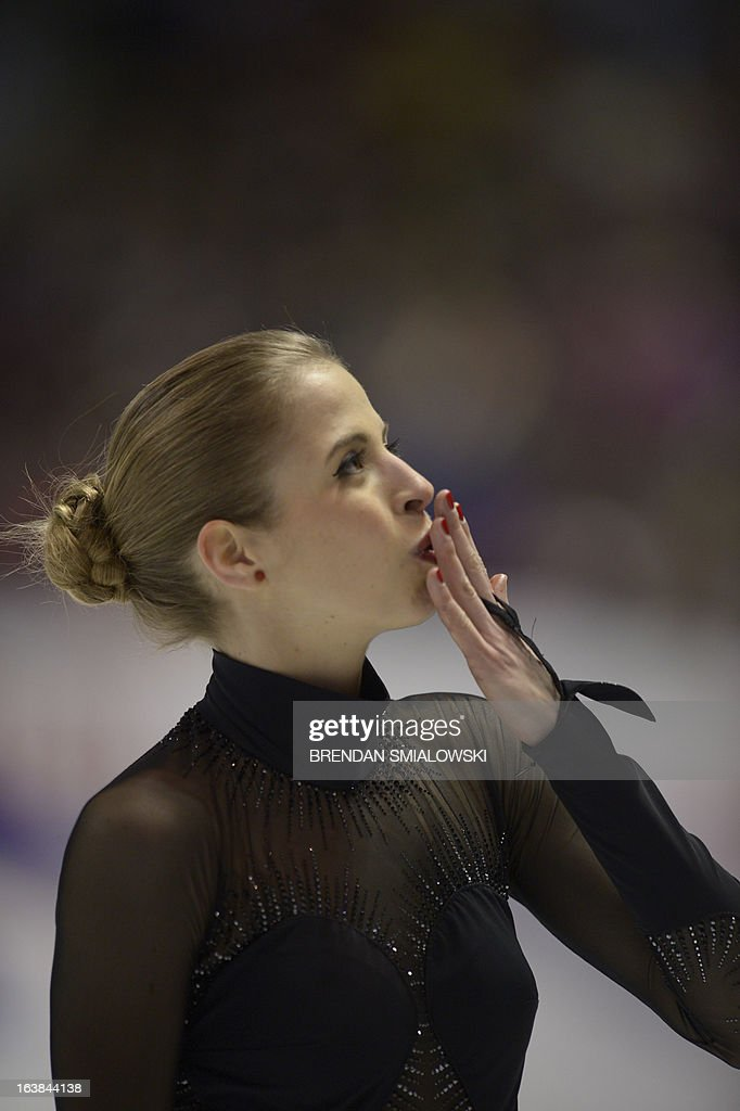 Carolina Kostner, representing Italy, acknowledges applause folowing her performance in the Ladies Free Skating event at the 2013 World Figure Skating Championships March 16, 2013 in London, Ontario, Canada. AFP PHOTO /Brendan SMIALOWSKI