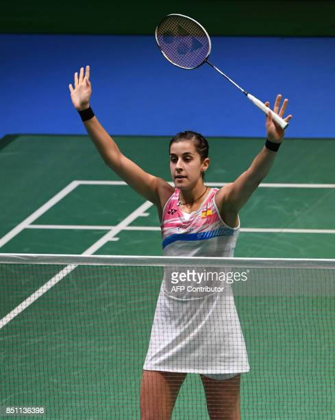 Carolina Marin of Spain acknowleges cheers after her victory over Akane Yamaguchi of Japan during the women's singles quarterfinal match at the Japan...