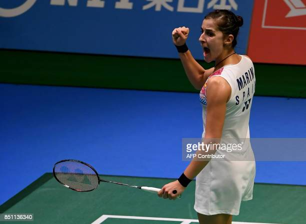 Carolina Marin of Spain clinches her fist after getting a point from Akane Yamaguchi of Japan during the women's singles quarterfinal match at the...