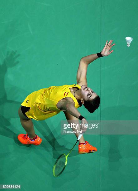 Carolina Marin of Spain compete against Sun Yu of China in the Women's singles match during day one of the BWF Dubai World Superseries Finals at the...