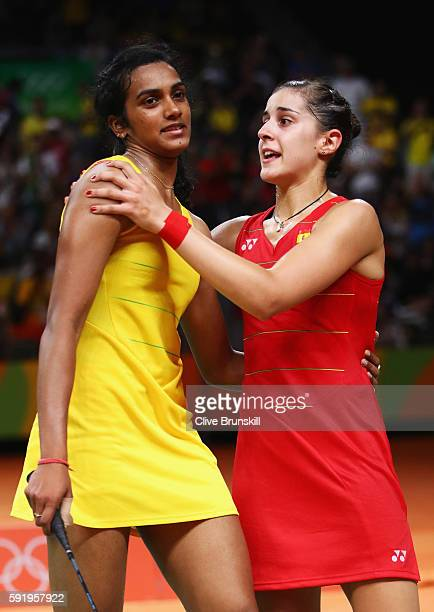 Carolina Marin of Spain embraces V Sindhu Pusarla of India after winning match point during the Women's Singles Gold Medal Match on Day 14 of the Rio...