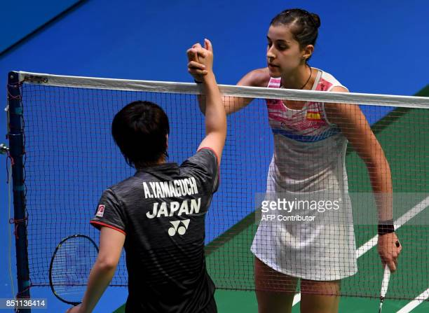 Carolina Marin of Spain is congraturated by Akane Yamaguchi of Japan during the women's singles quarterfinal match at the Japan Open Badminton...