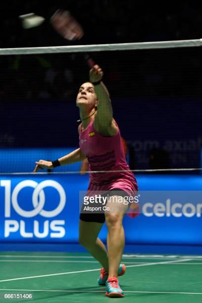 Carolina Marin of Spain plays a return shot to Nozomi Okuhara of Japan during the women's singles semi final of the 2017 World BWF Super Series...