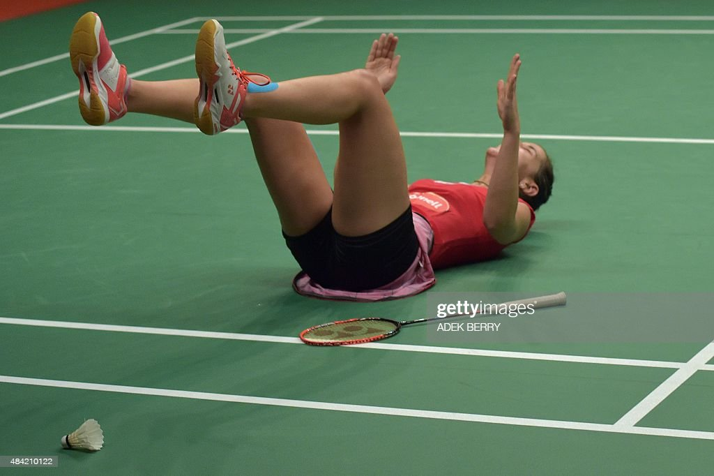 Carolina Marin of Spain reacts as she beats <a gi-track='captionPersonalityLinkClicked' href=/galleries/search?phrase=Saina+Nehwal&family=editorial&specificpeople=729912 ng-click='$event.stopPropagation()'>Saina Nehwal</a> of India to win the gold medal in the women's singles final at the 2015 World Championships Badminton tournament in Jakarta on August 16, 2015.